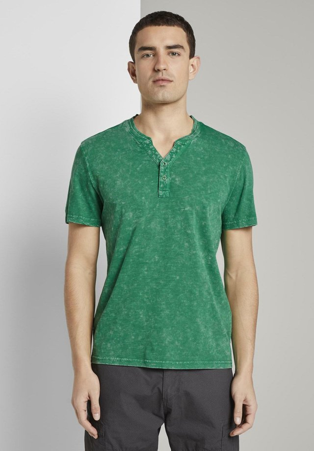 T-shirt con stampa - jolly green