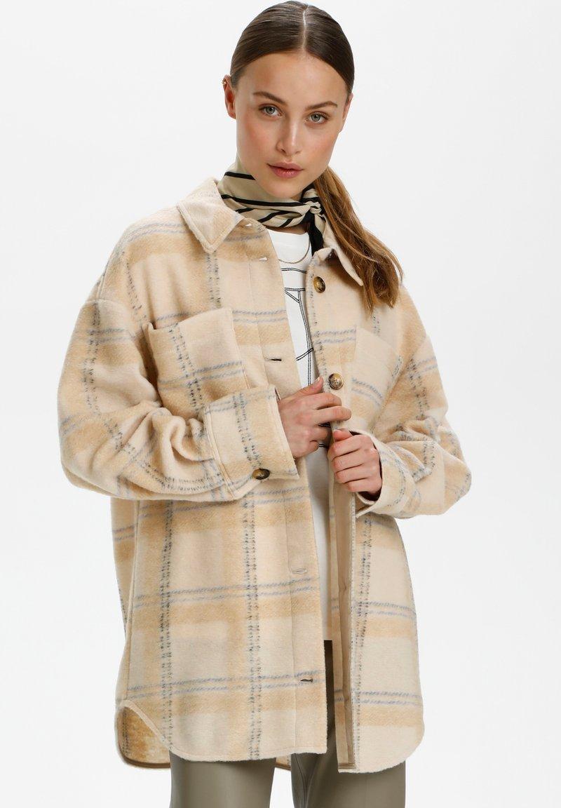 Soaked in Luxury - Short coat - sandshell check