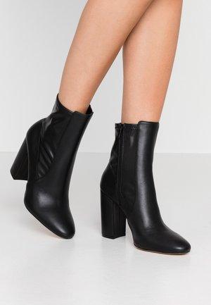 AURELLA - High heeled ankle boots - black