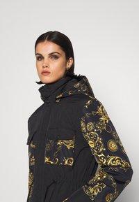 Versace Jeans Couture - OUTERWEAR - Parka - black/gold - 4