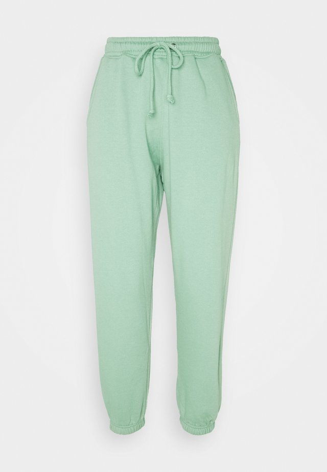 BASIC - Tracksuit bottoms - green