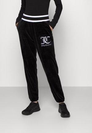 ARIANA JOGGER - Teplákové kalhoty - black