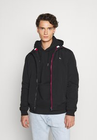 Tommy Jeans - ESSENTIAL PADDED JACKET - Light jacket - black - 0