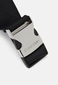 Calvin Klein - WAISTBAG UNISEX - Bum bag - black - 3