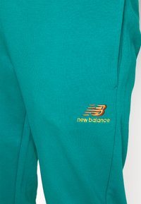 New Balance - ESSENTIALS EMBRIODERED PANT - Tracksuit bottoms - team teal - 4