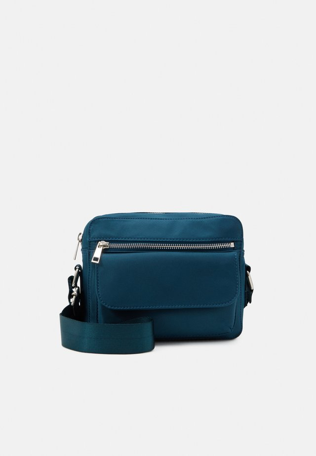 HALLI - Across body bag - dark green