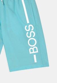 BOSS Kidswear - SWIM  - Swimming shorts - sea-green - 2