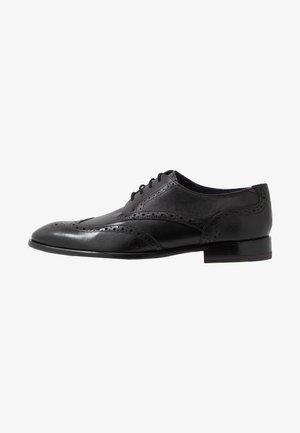 TRVSS - Smart lace-ups - black