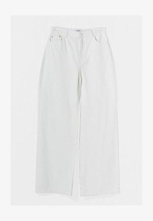 Fließende - Jeans a zampa - white