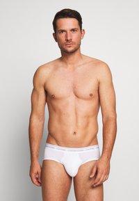 Calvin Klein Underwear - ONE HIP BRIEF - Briefs - white - 1