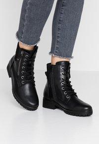 Jana - Šněrovací kotníkové boty - black - 0
