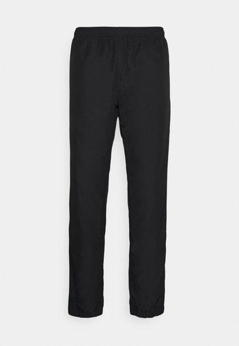 TENNIS PANT TAPERED - Pantalones deportivos - black/white
