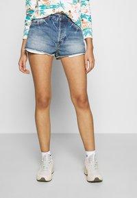Roxy - TRIGGER HIPPIE SISTER - Denim shorts - medium blue - 0