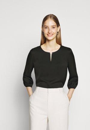 CAELA - Bluse - black