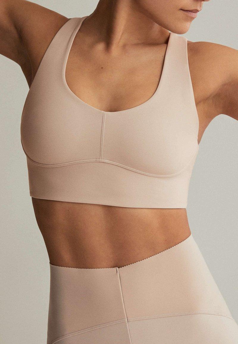 OYSHO - Medium support sports bra - beige