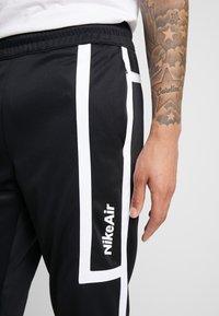 Nike Sportswear - M NSW NIKE AIR PANT PK - Verryttelyhousut - black/white - 3