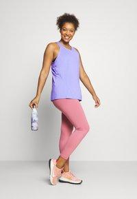 Nike Performance - TANK ALL OVER PLUS - Sports shirt - light thistle/(white) - 1