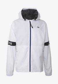 Lacoste Sport - TENNIS JACKET - Waterproof jacket - white/black - 4