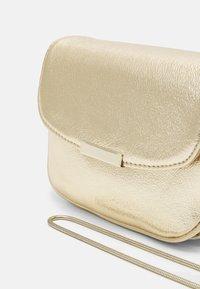 NAF NAF - Across body bag - light gold-coloured - 3