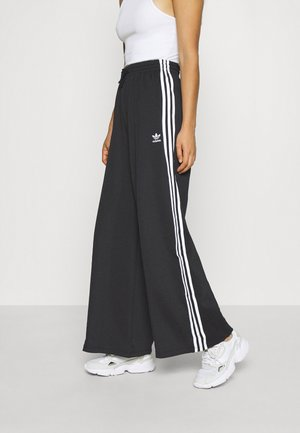 RELAXED PANT  - Verryttelyhousut - black