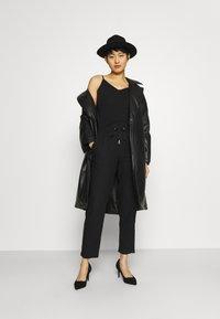 Marks & Spencer London - TAPERED - Trousers - black - 1