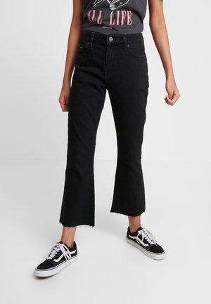 CROP FLARE - Široké džíny - black denim