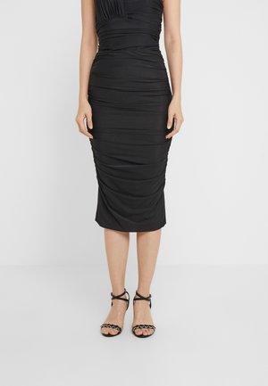 MEGALOMAN ABITO  - Pencil skirt - black
