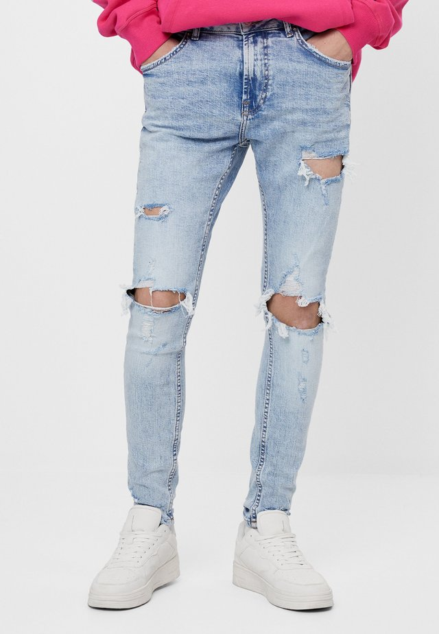 MIT RISSEN - Jeans Skinny Fit - light blue