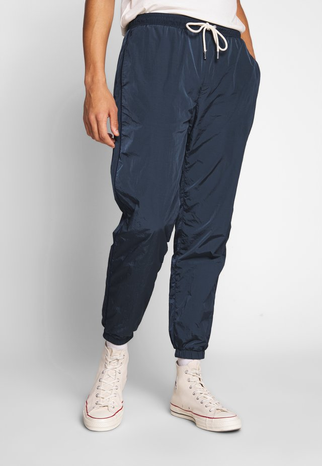 STADIO TROUSER - Tracksuit bottoms - navy