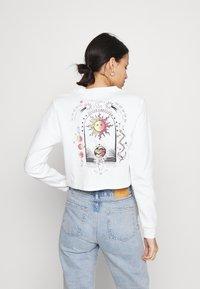 BDG Urban Outfitters - INNER EMPATHY WAFFLE CROP TEE - Long sleeved top - cream - 0