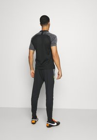 Nike Performance - DRY STRIKE PANT - Pantalones deportivos - black/smoke grey/black/volt - 2
