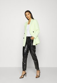 ONLY - ONLEMILY VENYL PANT - Trousers - black - 1