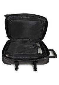 Eastpak - TRANVERZ - Wheeled suitcase - black - 5