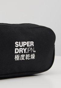 Superdry - SMALL BUMBAG - Bum bag - black - 2
