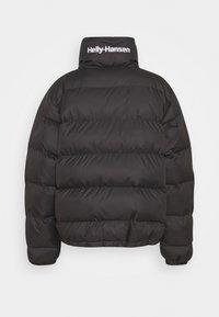 Helly Hansen - REVERSIBLE PUFFER JACKET - Winter jacket - black - 1
