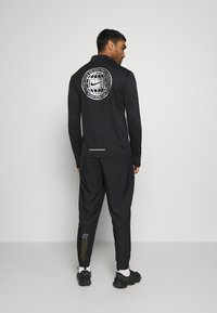 Nike Performance - ESSENTIAL PANT - Tracksuit bottoms - black/particle grey - 2