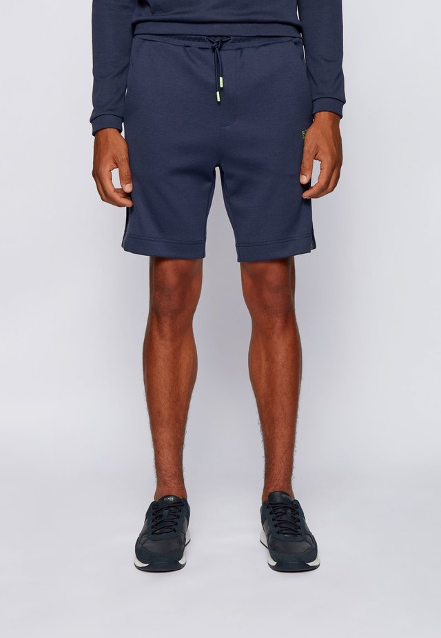 HEADLO ICON - Tracksuit bottoms - dark blue