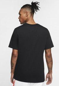 Jordan - JORDAN AIR WORDMARK MEN'S T-SHIRT - Print T-shirt - black/infrared 23 - 2