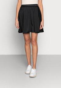 Calvin Klein Jeans - LOGO ELASTIC SKIRT - Mini skirt - black - 0