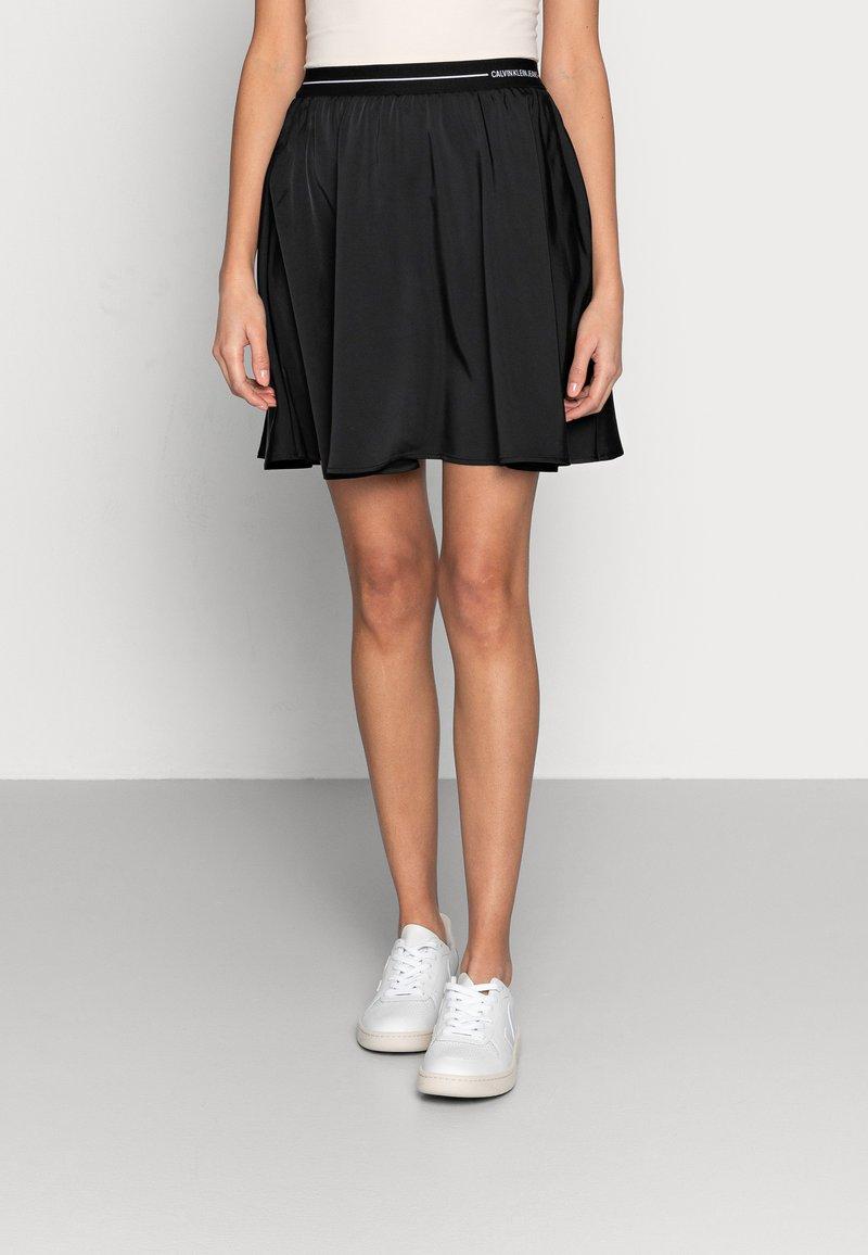 Calvin Klein Jeans - LOGO ELASTIC SKIRT - Mini skirt - black