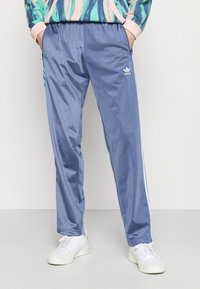 adidas Originals - FIREBIRD UNISEX - Tracksuit bottoms - crew blue - 0