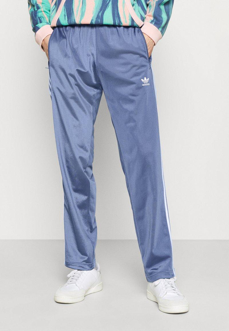 adidas Originals - FIREBIRD UNISEX - Tracksuit bottoms - crew blue
