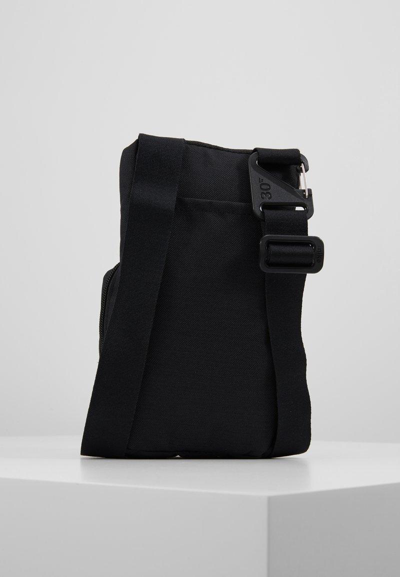 Nike Performance - KYRIE IRVING FESTIVAL BAG - Across body bag - black/dark smoke grey
