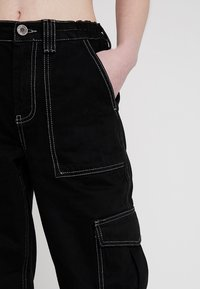 BDG Urban Outfitters - CONTRAST SKATE - Relaxed fit jeans - black - 3
