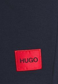 HUGO - Tracksuit bottoms - dark blue - 6