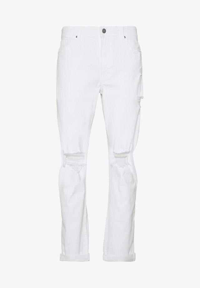 Zúžené džíny - white blowout