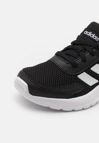 adidas Performance - TENSAUR RUN UNISEX - Neutral running shoes - core black/footwear white - 5