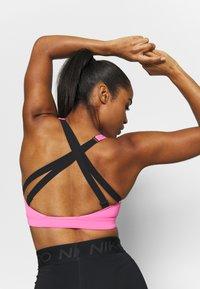 Nike Performance - IMPACT STRAPPY BRA - Sujetadores deportivos con sujeción alta - pink glow/black - 4