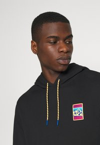 adidas Originals - HOODIE SPORTS INSPIRED  - Mikina s kapucí - black - 3