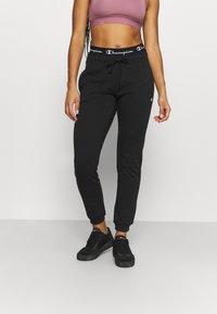 Champion - CUFF PANTS - Verryttelyhousut - black - 0